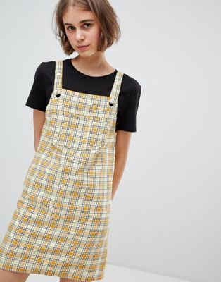 c0d85057347 Image 1 of Monki Check Mini Overalls Dress in Yellow