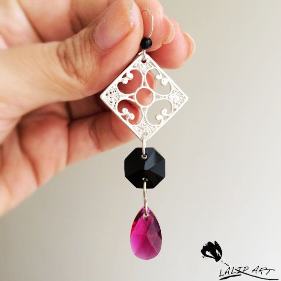 Handmade silver earring with Swarovski crystals.silver part is fully hand made which I designed and made