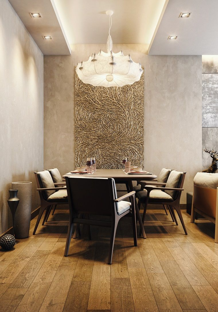 Saloni moderni con un divano imbottito e sala da pranzo con tavolo ...