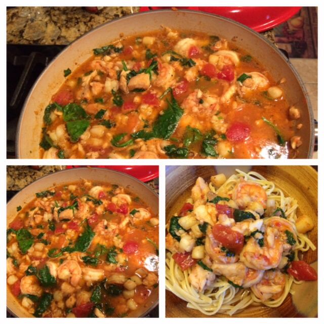 Shrimp, scallops, talapia... Fresh spinach, diced tomatoes, garlic, dry white wine, chicken broth, tomato paste over linguini
