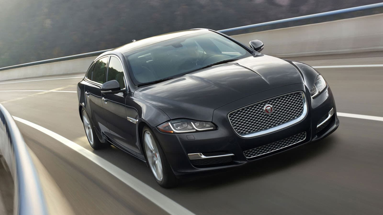 View The Jaguar Xj Photo Gallery Showcasing The Advanced Features And Technology That Offer A One Of A Kind Luxury Driving Experie Jaguar Xj Jaguar Car Jaguar