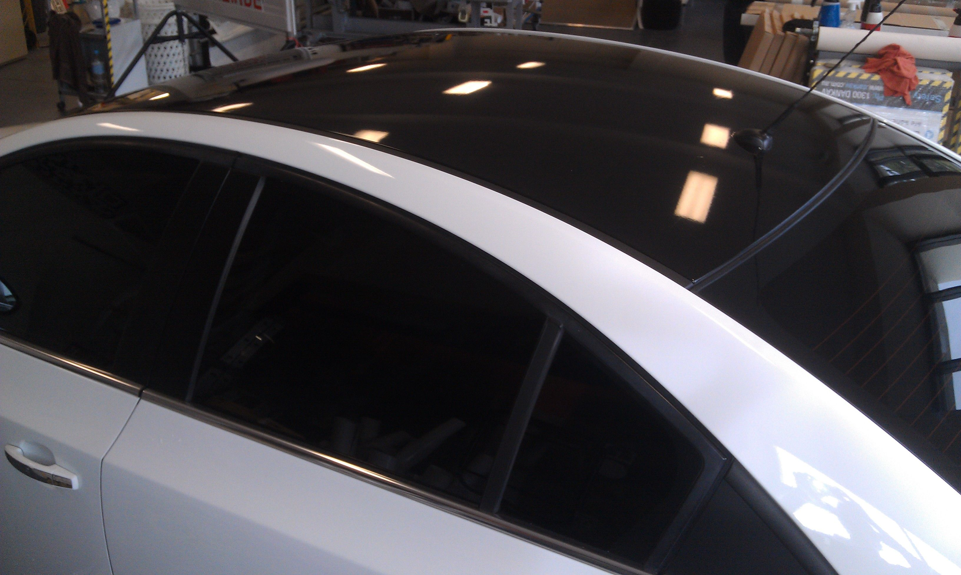 Wrapping The Roof Of Your Car To Make It Look Super Slick Black Gloss Vinyl Works A Treat Car Car Wrap Gold Coast