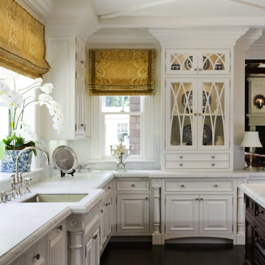 Corner window kitchen sink  traditional kitchen design with white cabinetry carrara marble