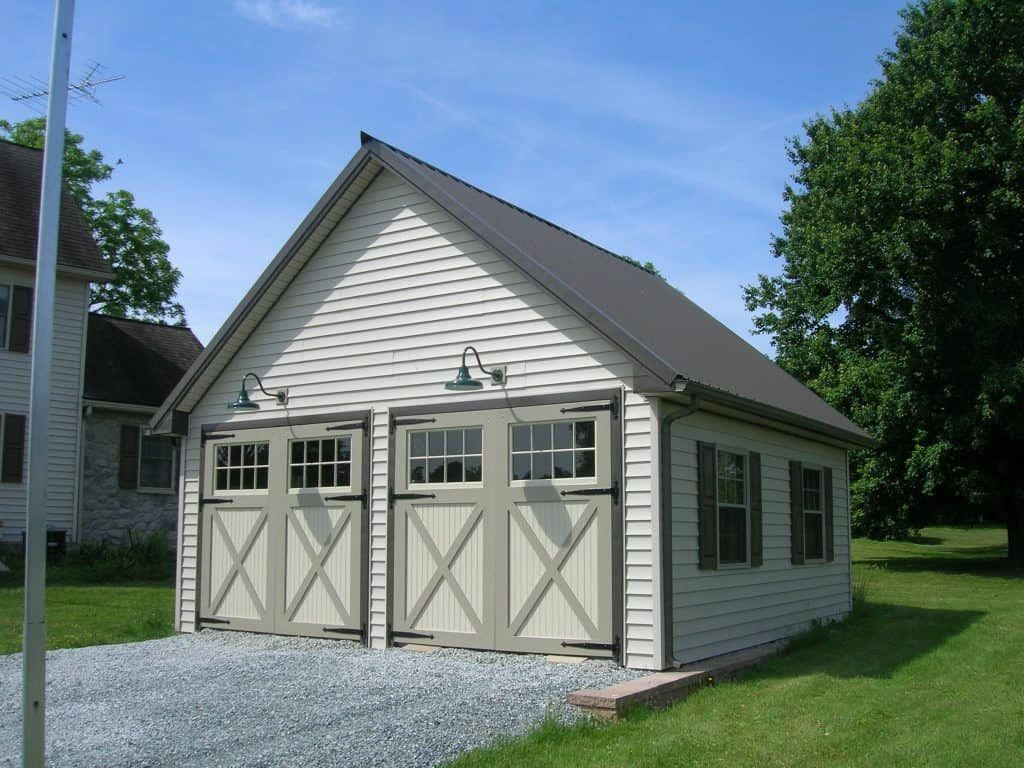 white pole barn garage double doors Metal buildings