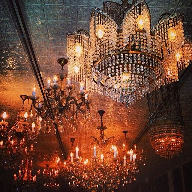 Crystal chandeliers glistening on an evening in a hotel in Bali ...