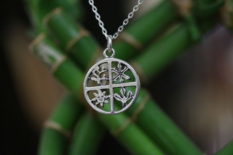 The four season charm is a symbols of life, love, and new beginnings. To remember that their is always a start after an end.   ​Make from sterling silver (925) stamp on the back. The price does not include chain or bracelet does are for purchase individually.