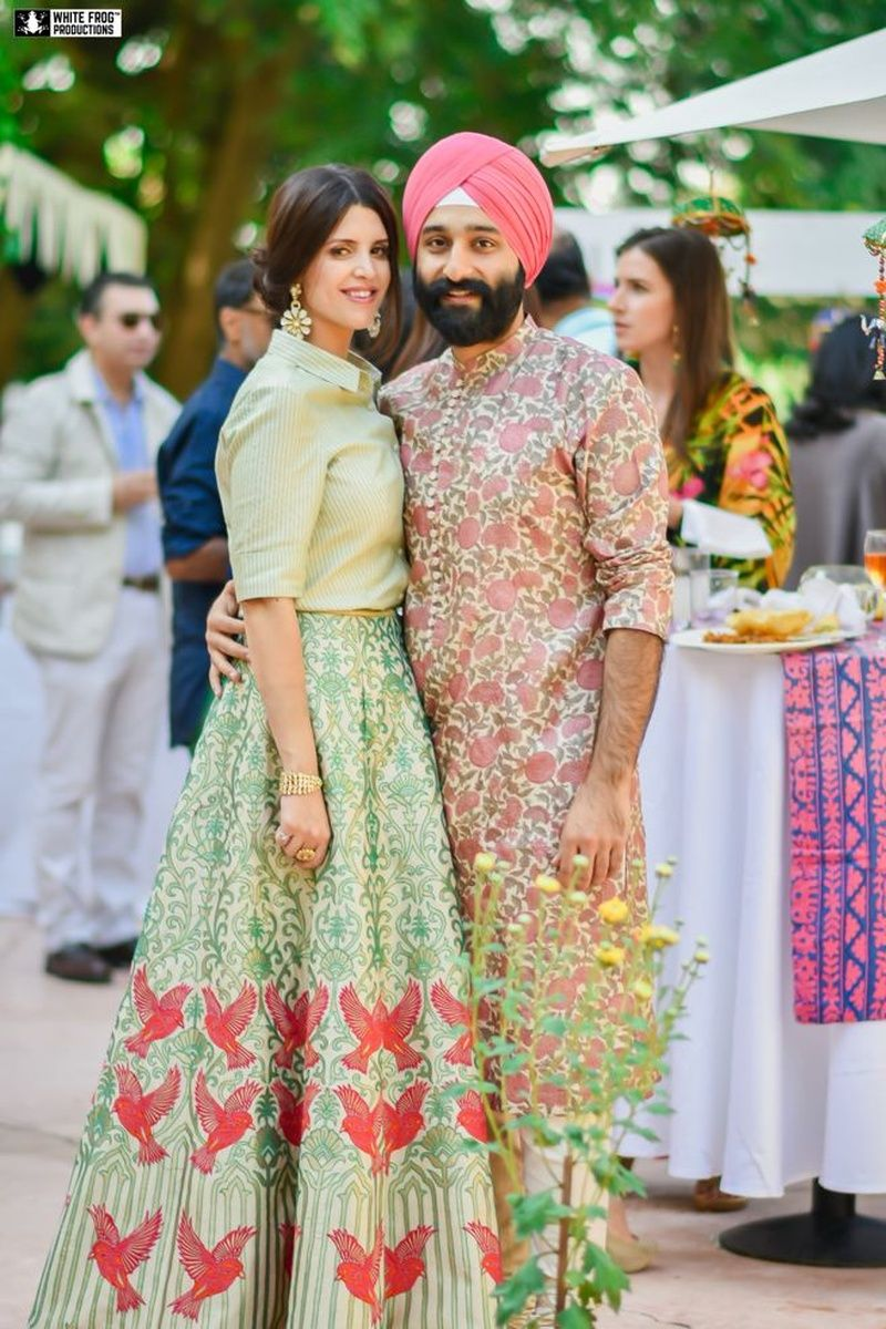 Complementing each other with floral printed mehendi outfits