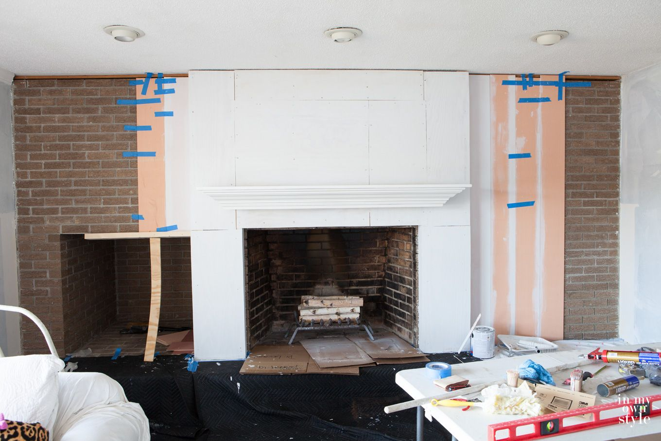 Brick fireplace wall makeover using vertical wood planking