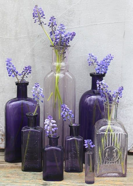 I like the mismatched vases, but in pinks not purple