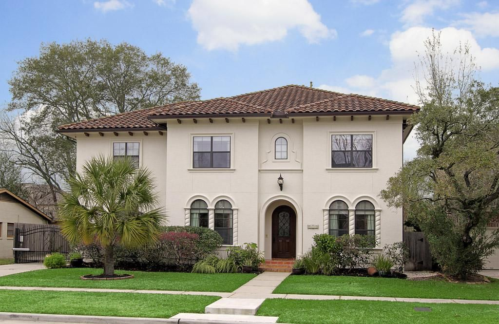 Custom spanish colonial style home with a just completed for Spanish style interior shutters