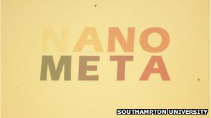 A piece of gold with the words Nano Meta written on it in colours.  Coloured gold jewellery could be a reality