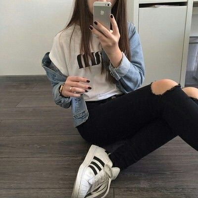 Stylish teen outfit: tumbler ripped jeans Adidas shoes And a jean jacket