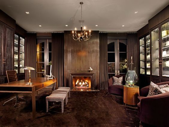 wooden home office. Home Office With Dark Wood Paneling, Brown Brass Chandelier, Wooden Desk And Two Armchairs