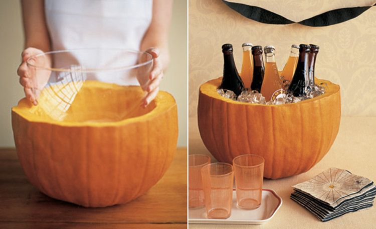Put a glass bowl in a hollow pumpkin to hold punch or use as a cooler. #halloween #decoration #party #ideas