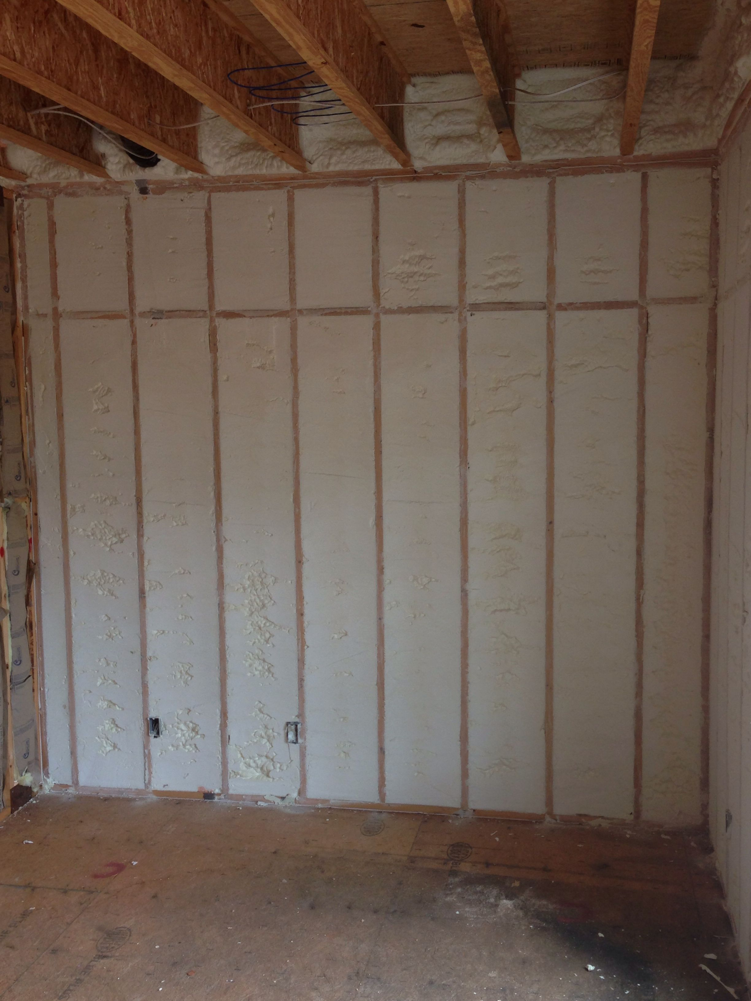 Open Cell Spray Foam Installed On Exterior Walls Of New House