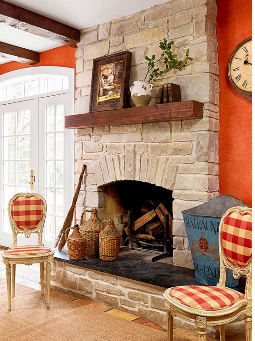 Like the raised hearth stone fireplace design french
