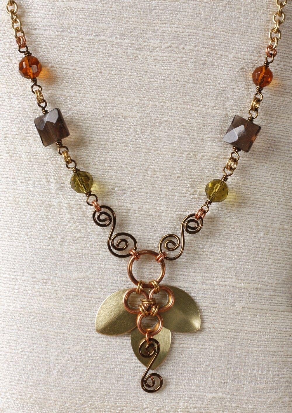 Autumn petals necklace: gold, copper, wire wrapped smoky quartz, spirals. $45.00, via Etsy.