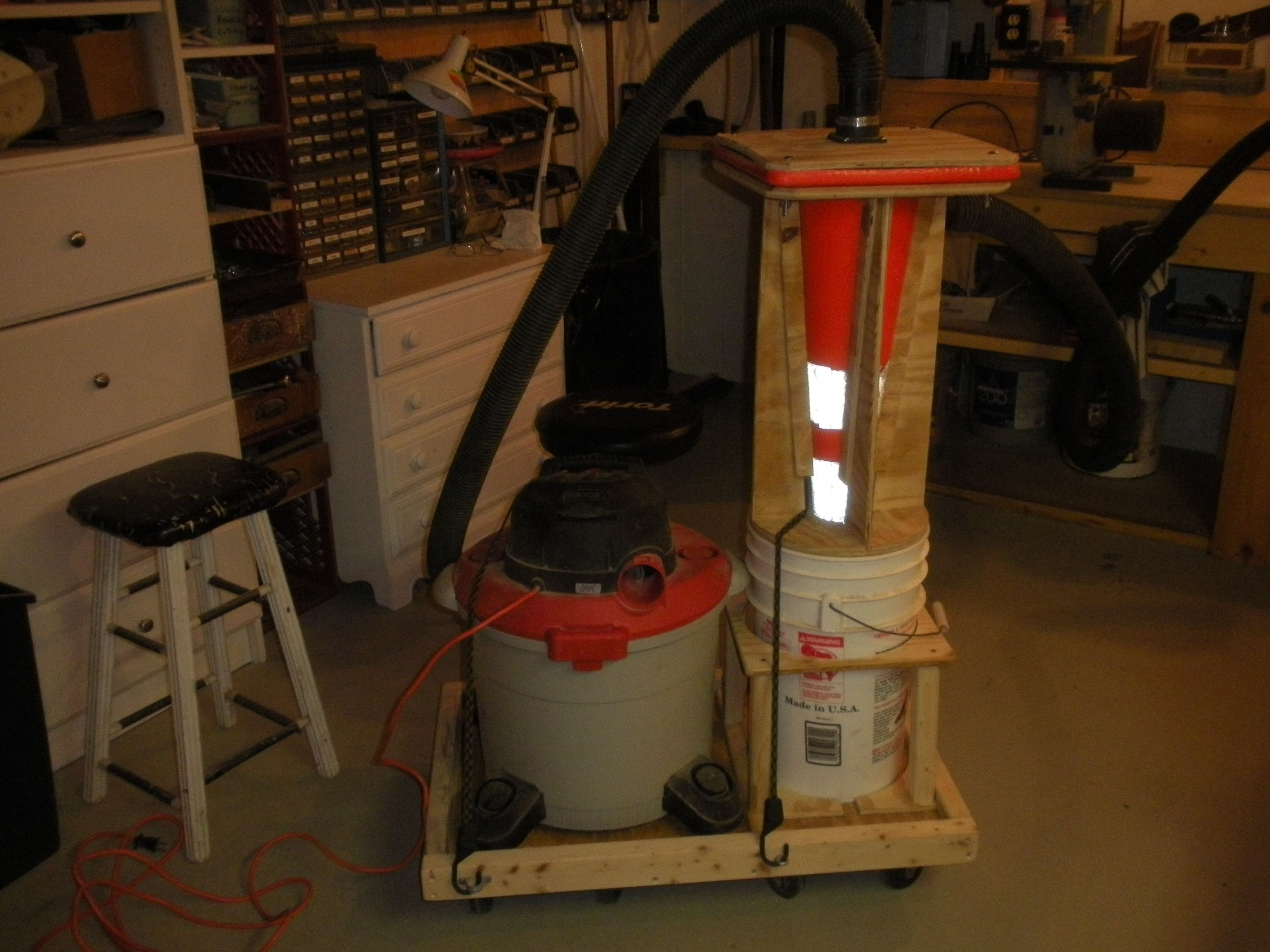 Cyclone Sawdust Collector From Traffic Cone. Cart Is Snugged Onto A Couple  Of Furniture Dollys