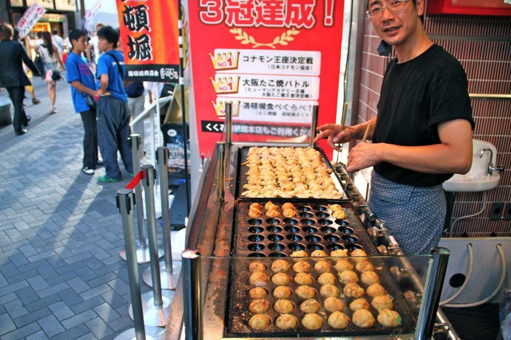 Takoyaki, delicious octopus balls, street food of Osaka, Japan