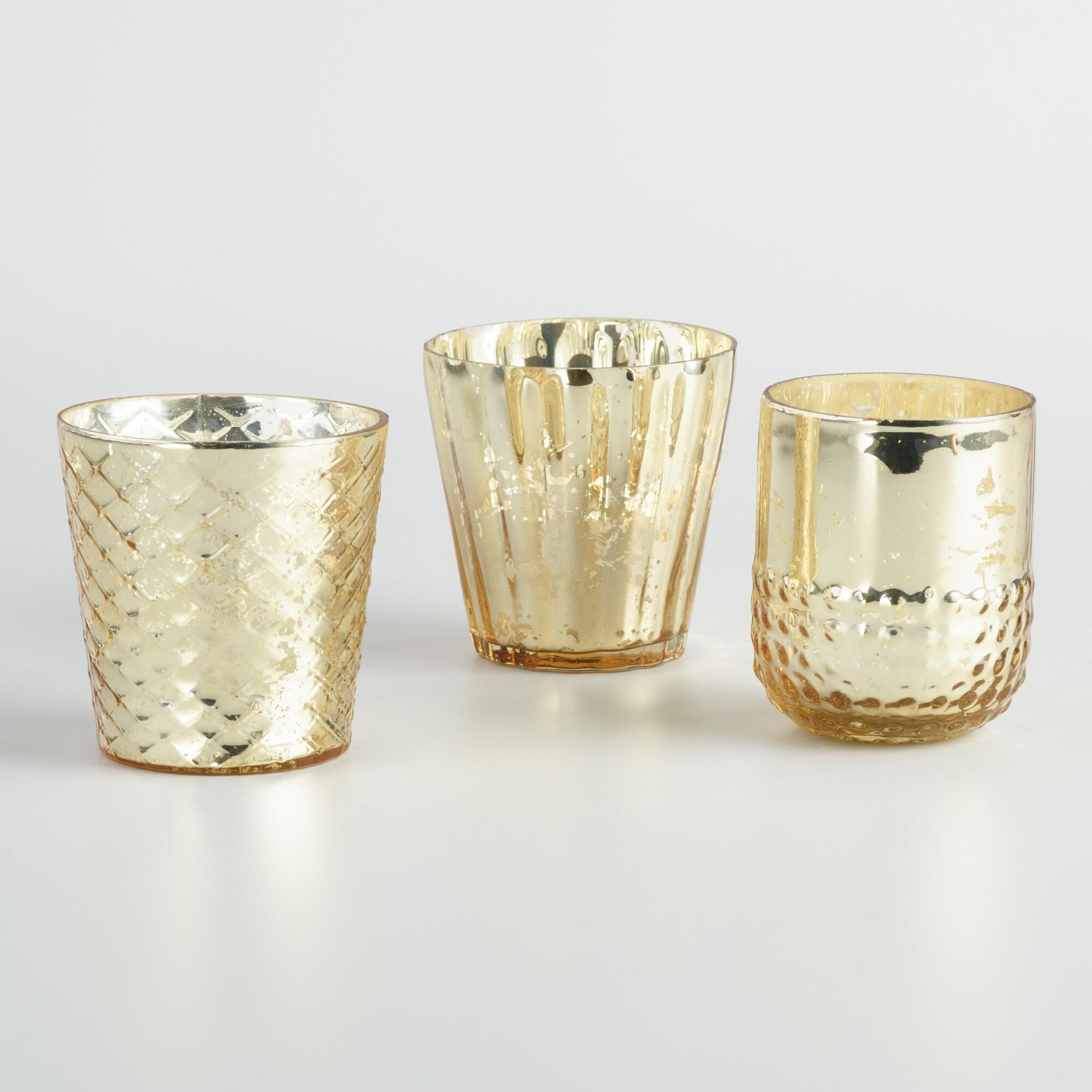 Create a sophisticated display of candlelight with our set of votive holders. Handcrafted of mercury-finished glass by artisans in India, each features a unique textured pattern.