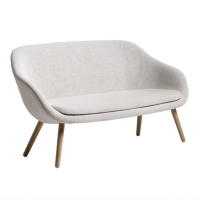 About A Lounge Sofa is designed for Hotell Comwell in Århus, Denmark. Seat:Hard moulded polyurethane, upholstery 4 leg base:Solid oak, soap treated, laquered or black stained Dimensions: 150 x D 55/73 x H 40/81