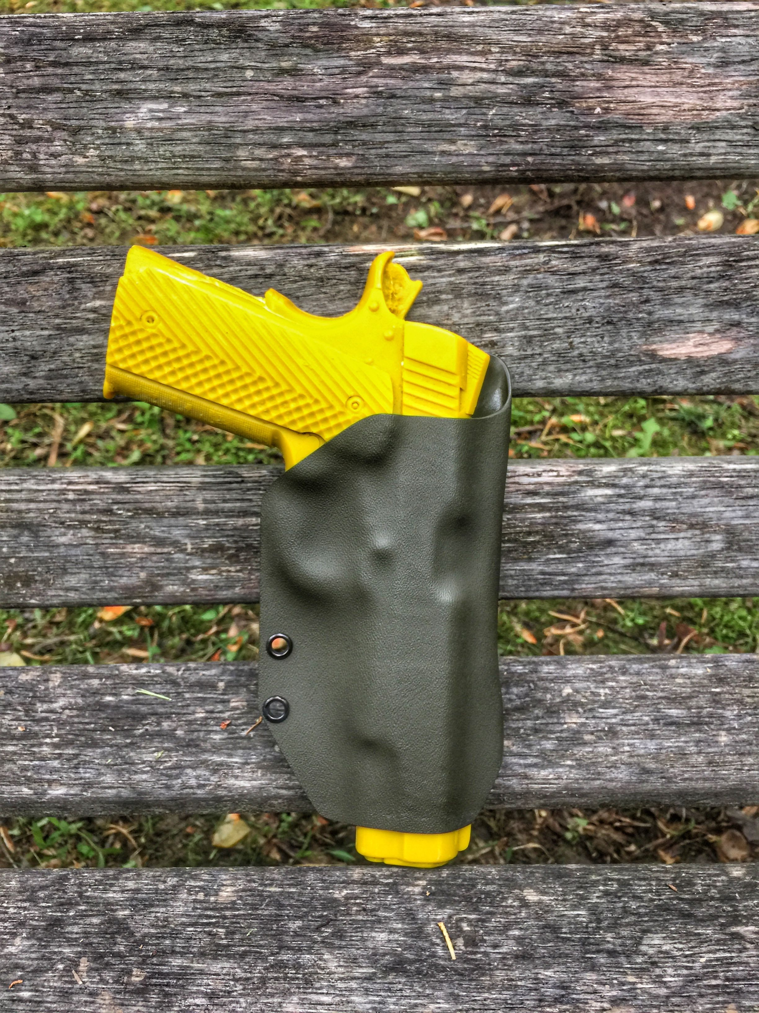 Finished olive drab kydex owb holster with a teklok clip