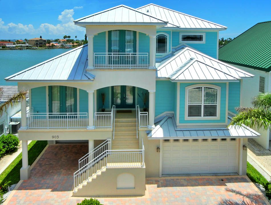 I love this florida keys home the color scheme is perfect for Coastal home plans
