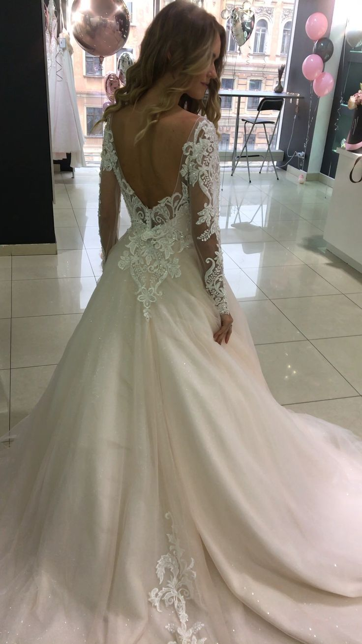 Long sleeve wedding dress Ivis by Olivia Bottega. Open back. Sequins tulle. A line wedding dress. Lace wedding dress. Tulle wedding dress.
