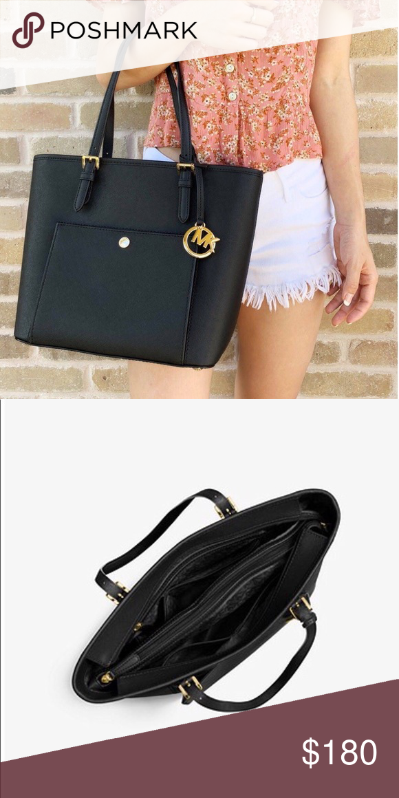 1cb7a76e7fc7 Michael Kors Black Saffiano Leather Purse This purse has been used a few  times but is in great condition! . I m open to offers and up for  negotiations.