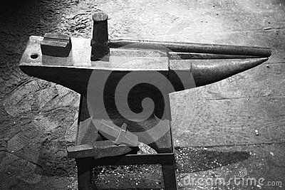 This is a vintage blacksmith's hammer and anvil setup at a live reenactment blacksmithing shop at the Shelburne Museum in Vermont.