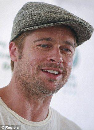 d9c418fd5eb Brad Pitt sporting a flat cap