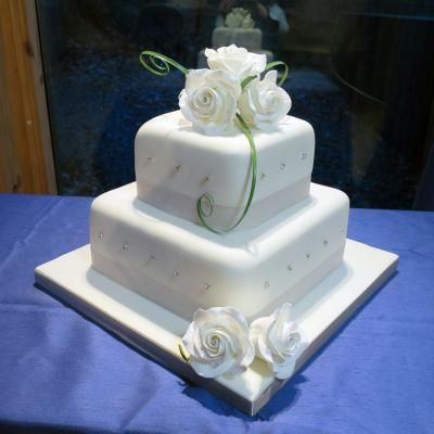 Two Square Tiers Simply Decorated With Hand Made Ivory