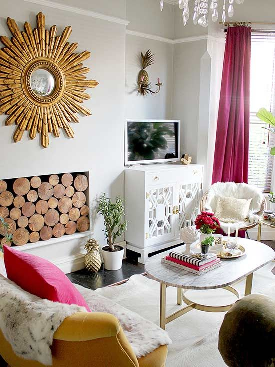 beautiful large starburst mirror above fireplace - 9 Bold Mirrors to Reflect Your Impeccable Style
