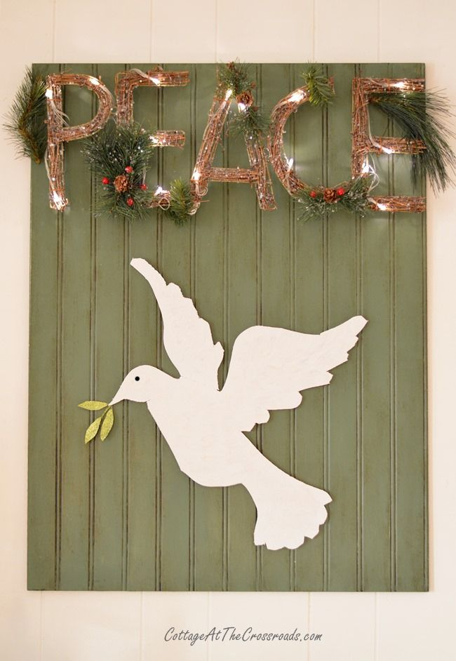 A Peaceful Christmas Mantel | Cottage at the Crossroads DIY PEACE rustic woodland marquee and White Dove.