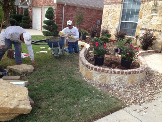 Stone border with brick cap landscape flowerbed edging for Landscaping flower beds with stones