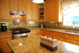 Venetian Gold Granite Countertops With Light Maple Cabinets And