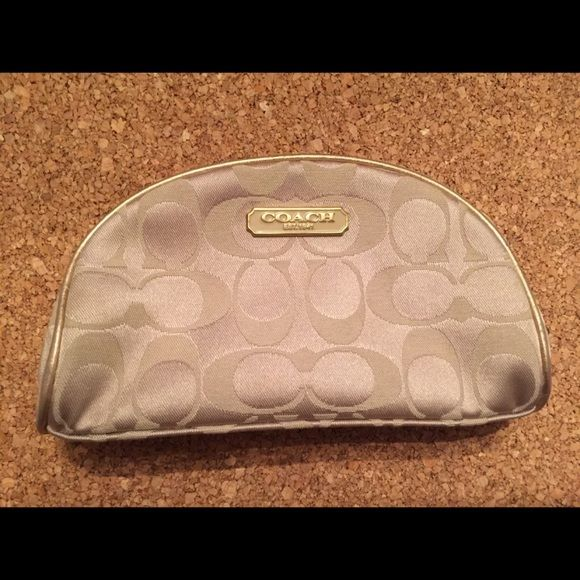 "Coach cosmetic bag. Never used The inside says ""Limited edition coach cosmetic case was designed by Coach, exclusively for Estee Lauder, Holiday 2010."" Coach Bags Cosmetic Bags & Cases"