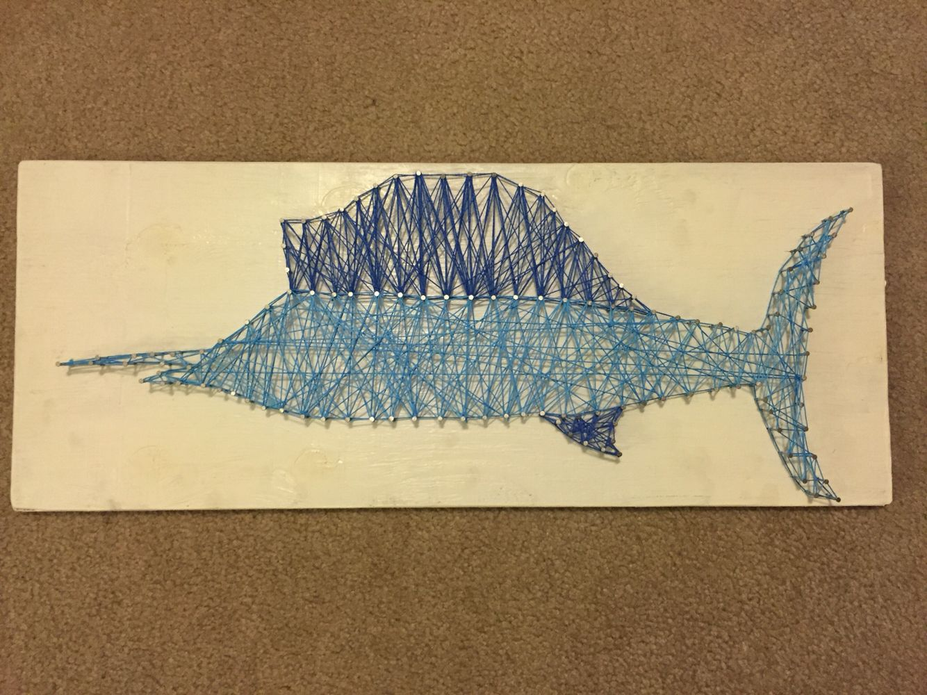 String art Sailfish. Two shades of blue for the fish on a white ...