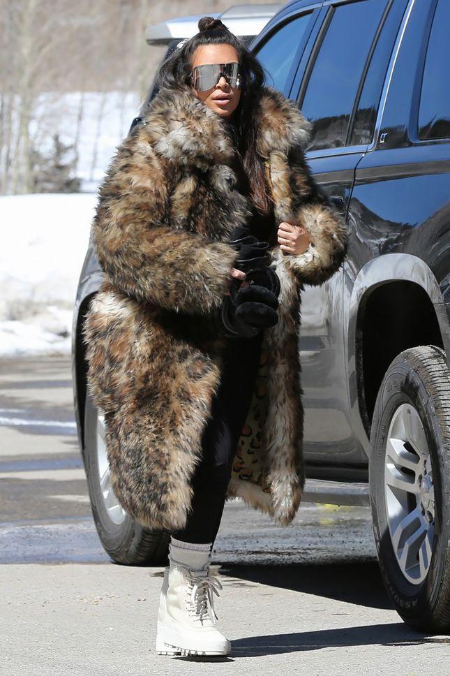8c4d326d5b Kim Kardashian West in Louis Vuitton Coat and Yeezy Boots