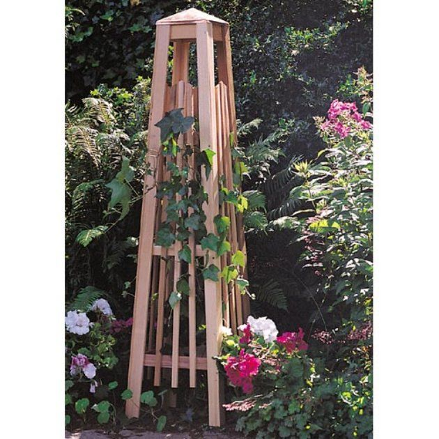 Love Garden Pyramids And Obelisks   Lowes And Home Depot Have A Solar Light  That Is The Shape Of The Top Of This One!