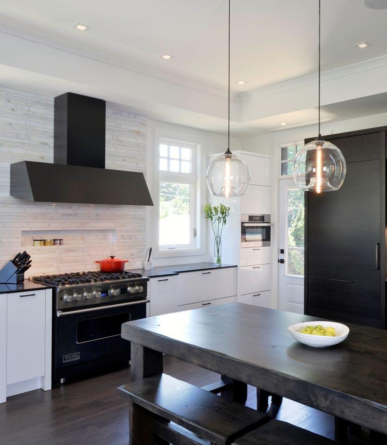 Modern Kitchen Range black stove hood in a white kitchen |  range hood was colored
