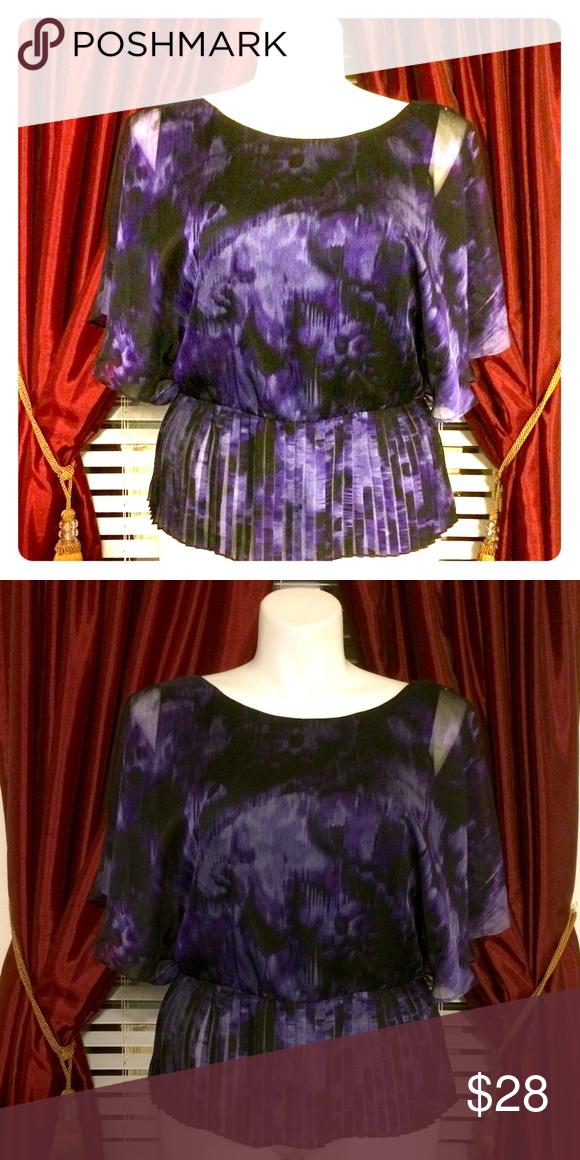 """Purple Pleated Peplum....Say THAT 3 Times! Purple/black/Lilac print top, fully lined with dolman sleeves. 100% polyester. Measures 49"""" bust, 24"""" shoulder to hem, waist:33""""-38"""" (elastic waistband) Collection Dressbarn Tops Blouses"""