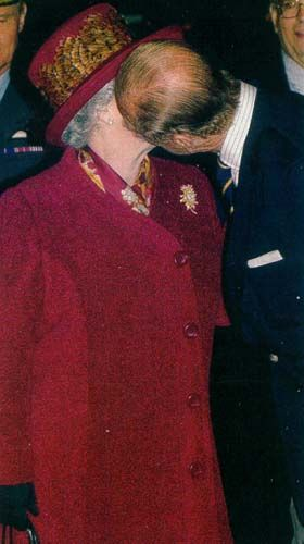 unusual moment... Prince Philip give the Queen a kiss. The Prince is feeling a little randy! Sweet!