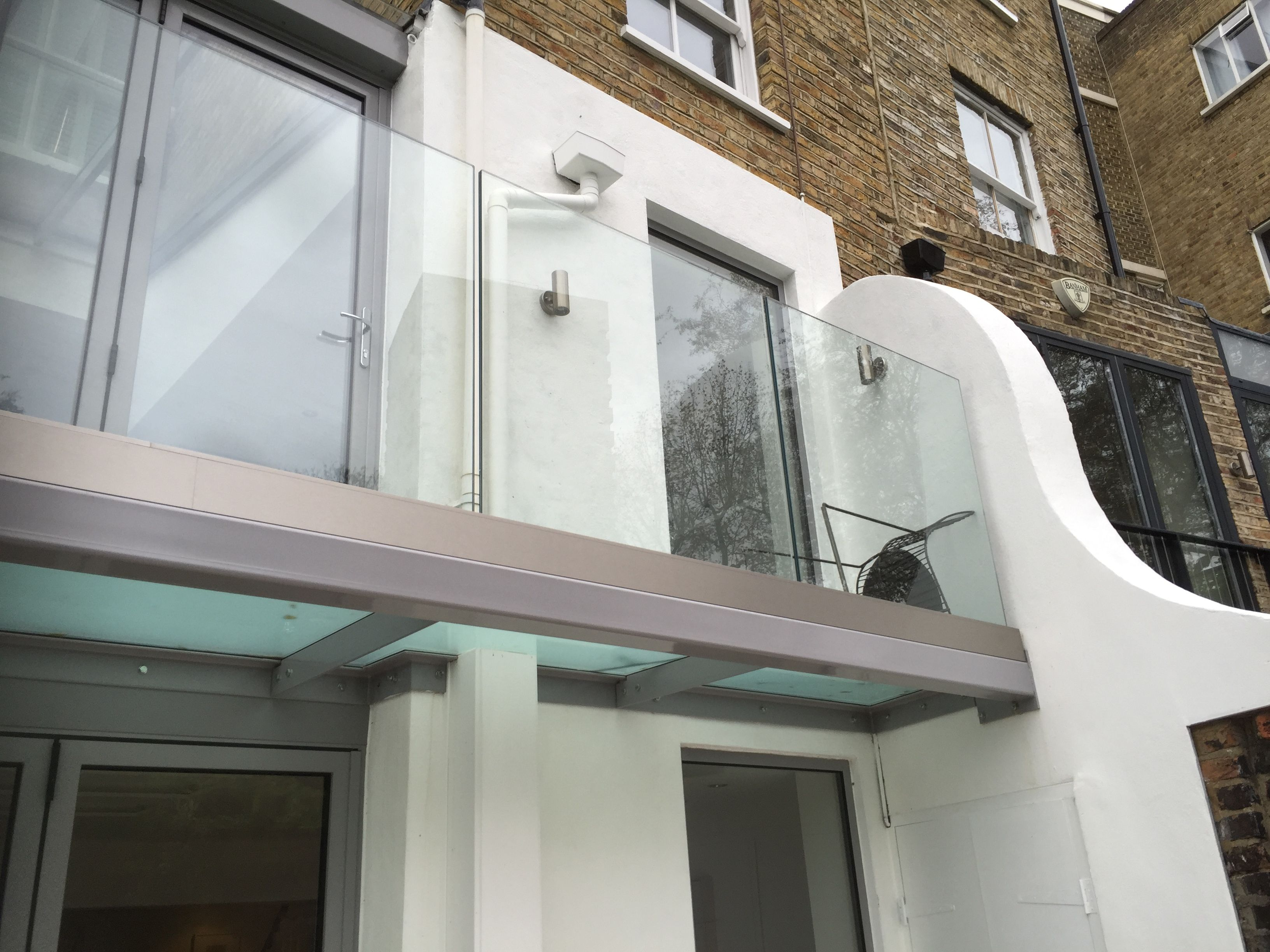 Walk out balcony design complete with glazed floor and infinity ...