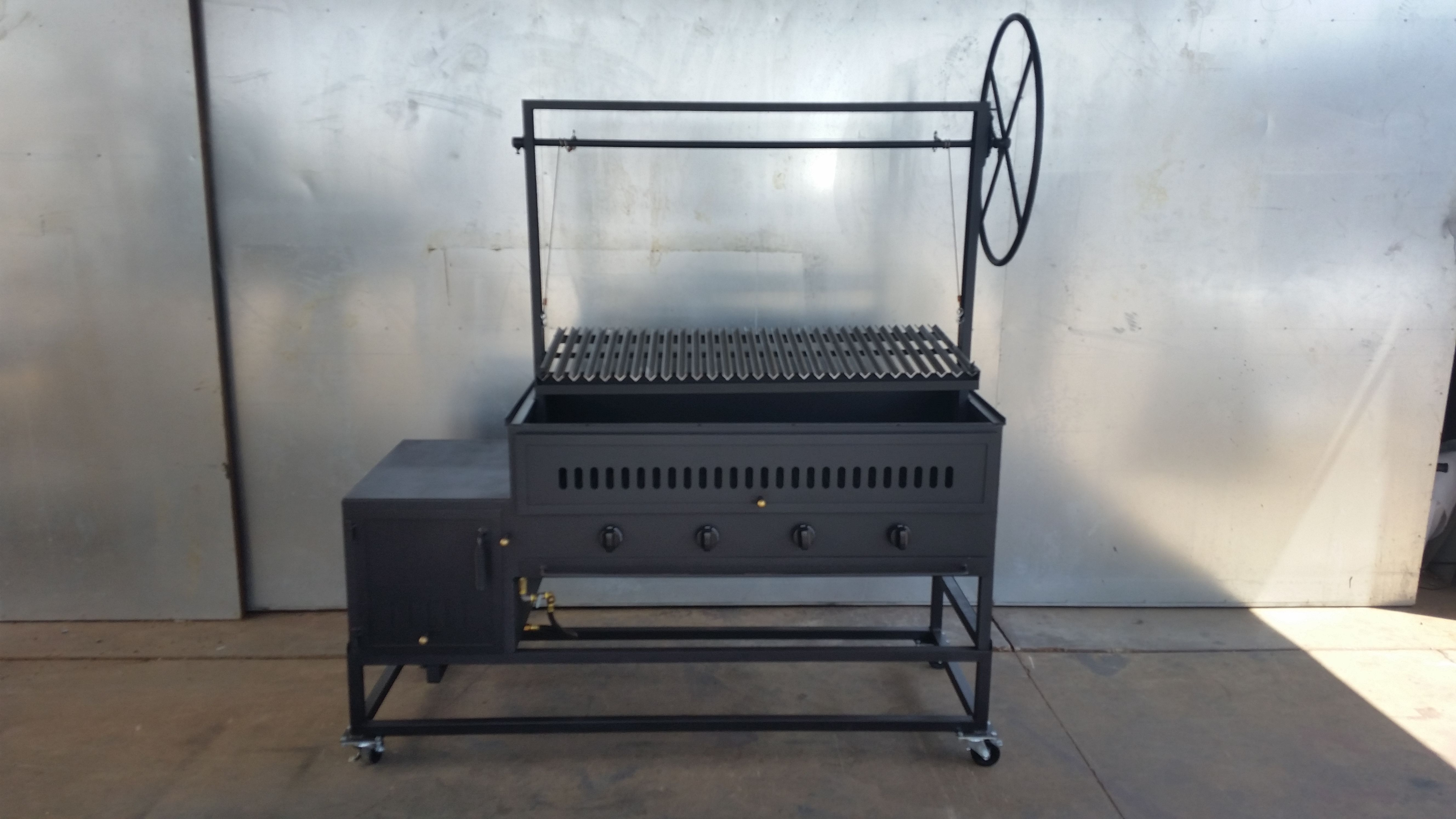 "48"" hybrid grill with offset firebox and argentine grate set on top"