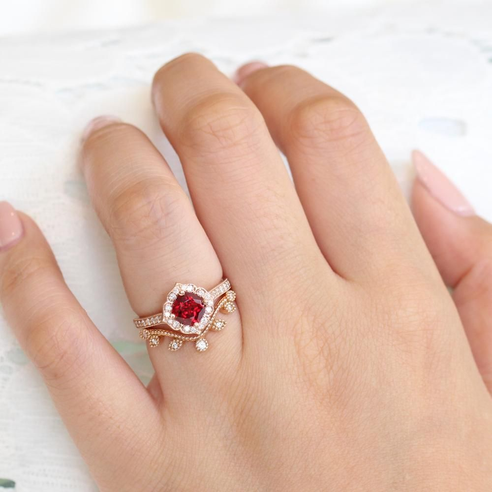 Vintage Style Ruby Bridal Set Features A Cushion Ruby Engagement Ring In Rose In 2020 Ruby Engagement Ring White Topaz Engagement Ring Vintage Floral Engagement Rings