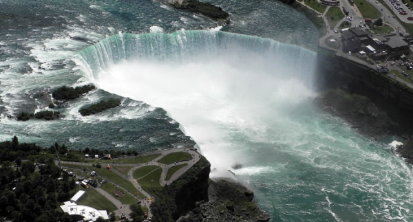 This aerial view shows the Horshoe section of Niagara Falls on June 14 2012 in Niagara falls, New York. A wire, 1,550 feet (472 meters) long, at the mouth of the falls will be used by high-wire walker Nik Wallenda, 33, on June 15 to cross from the US (L) to Canada over the Horseshoe. Wallenda will be suspended 173 feet (53 meters) above the falls.