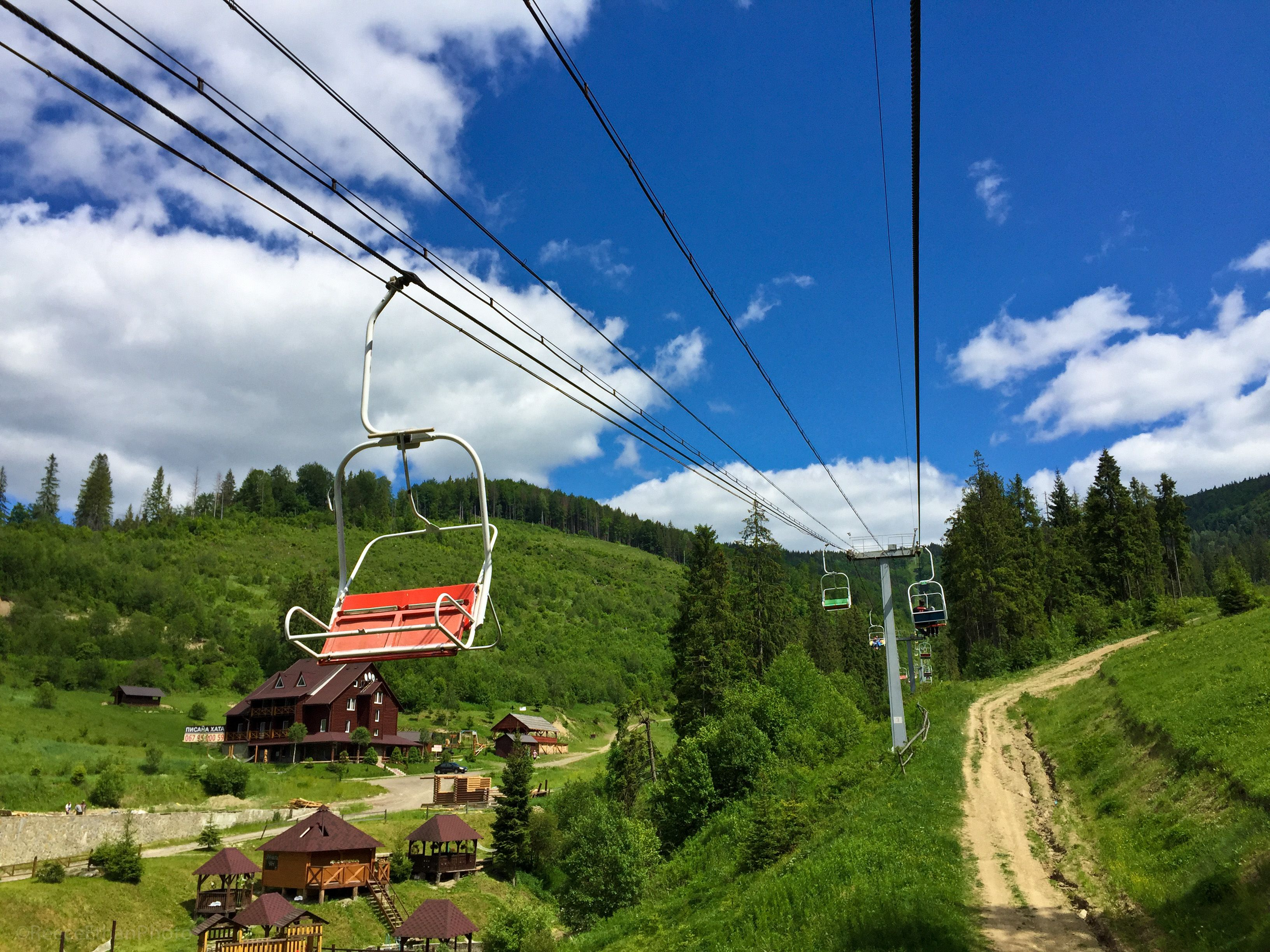 Red chair on a ski lift in the Carpathian Mountains near