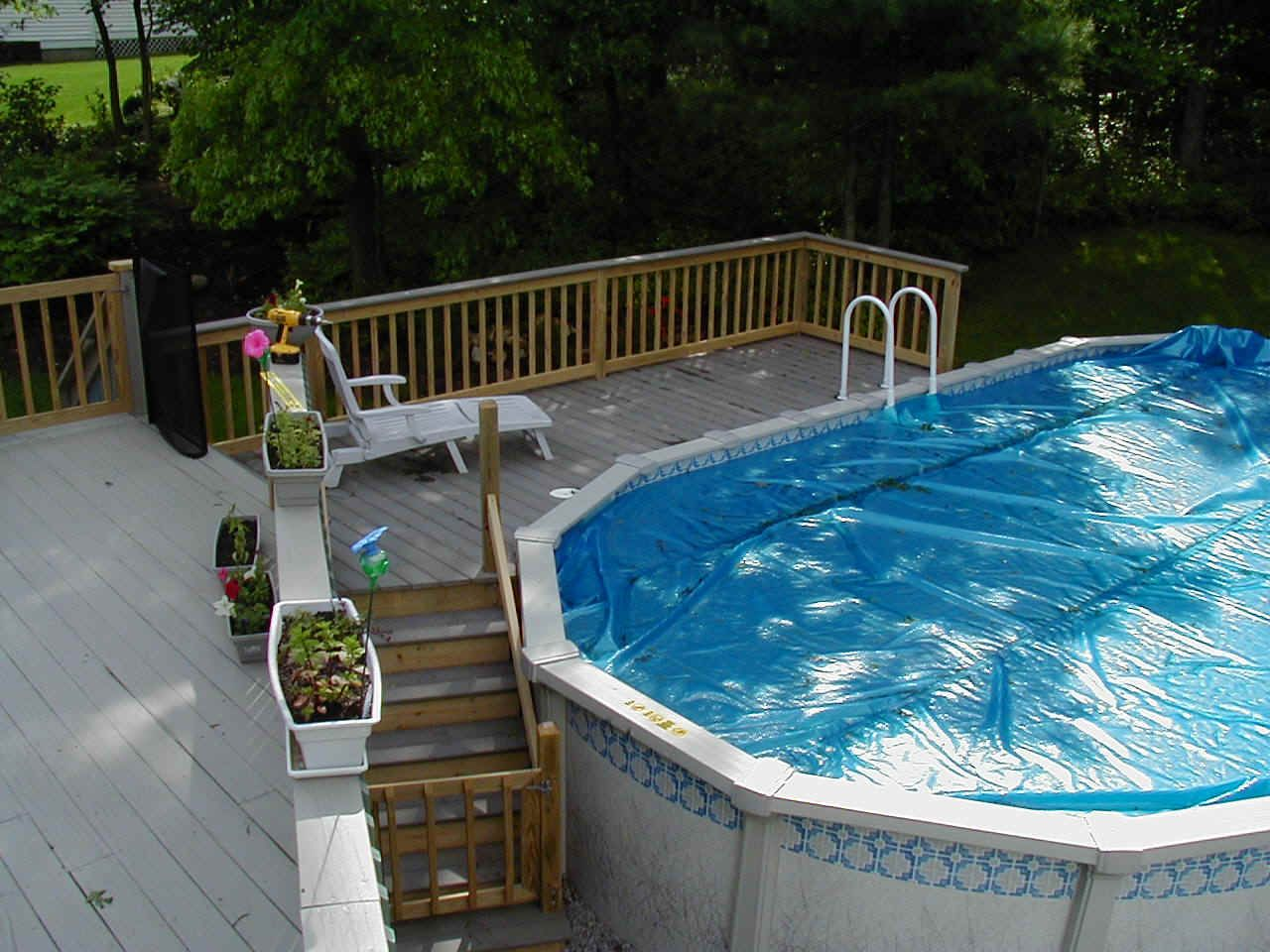 You can use wood deck plans and designs for wooden decks for Above ground pool cover ideas