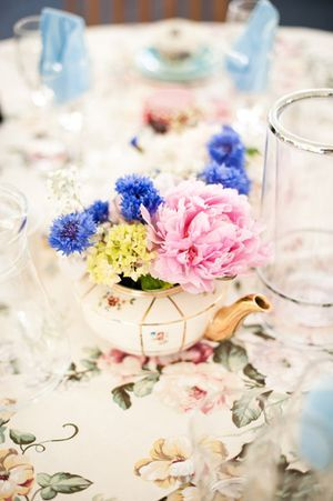 teapot vases - 1930's Bloomsbury Garden Party Inspired Wedding I like the print on the tablecloth....for napkins??